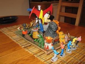 Godzilla and friends sit in the center of the Kaijucast Thanksgiving spread.